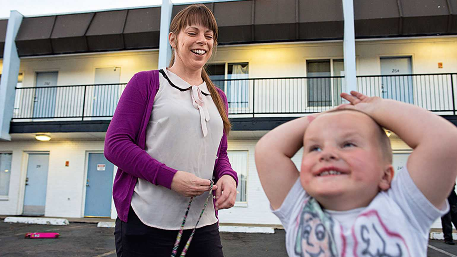 Marsha Carey, the interim project manager of Denver's Family Motel, with one of the children staying there