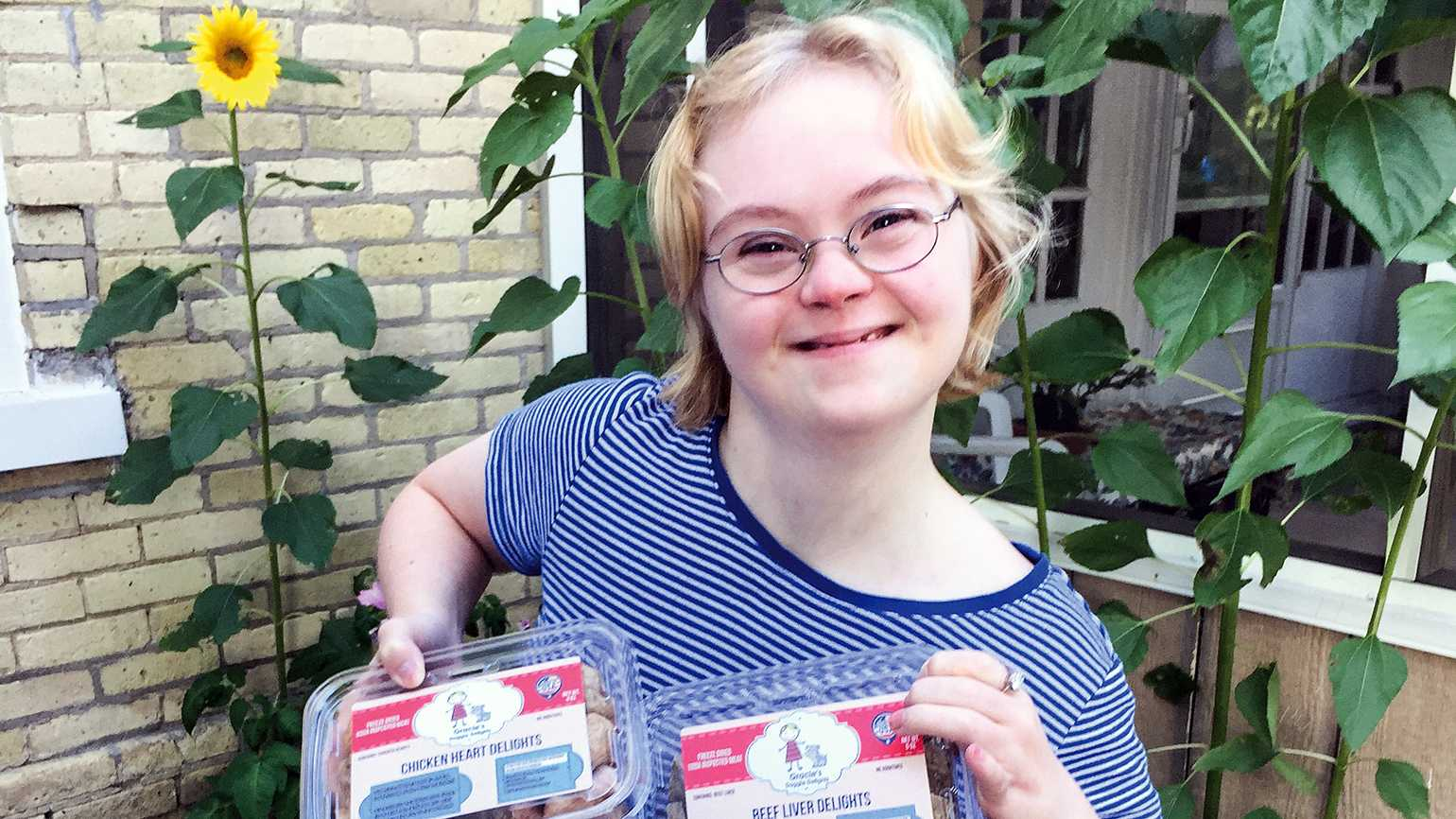 Gracie Jagler poses with some of her Doggie Delights