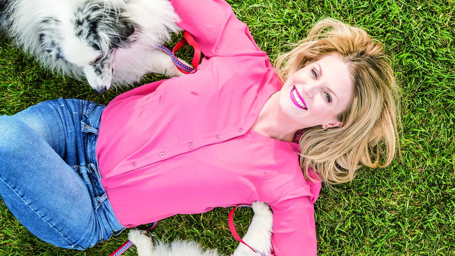 Alisa Johnson, founder of Dogs on Deployment, poses with her two dogs.