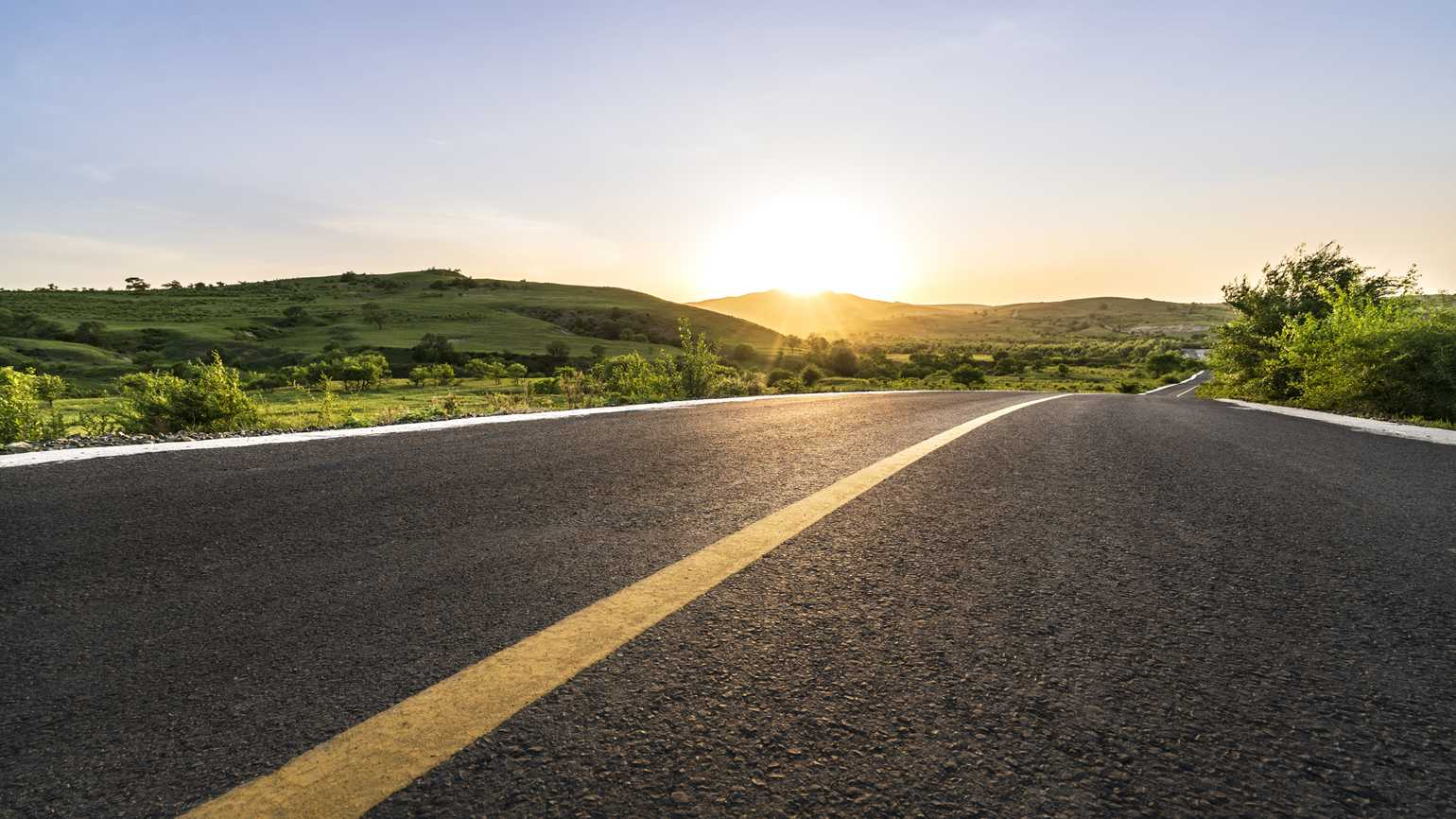 A road with sunshine at the end.