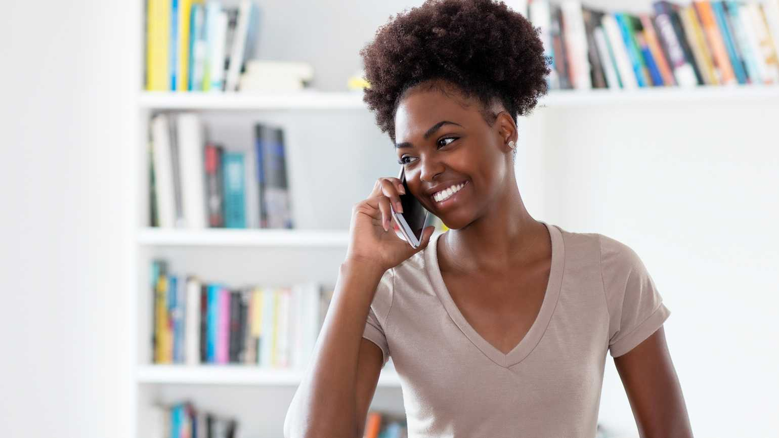 A woman on a phone call; Getty Images