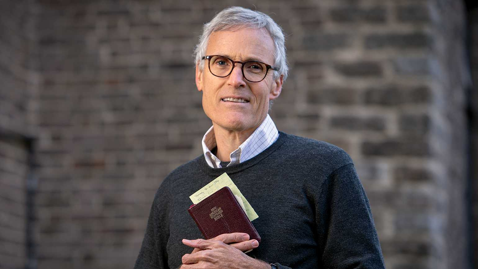 Rick Hamlin with his father's Bible; photo by Jim Anness