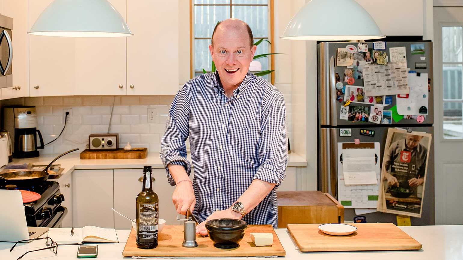 Sam Sifton cooking in his home in Red Hook, Brooklyn. Photo by Stephen Speranza