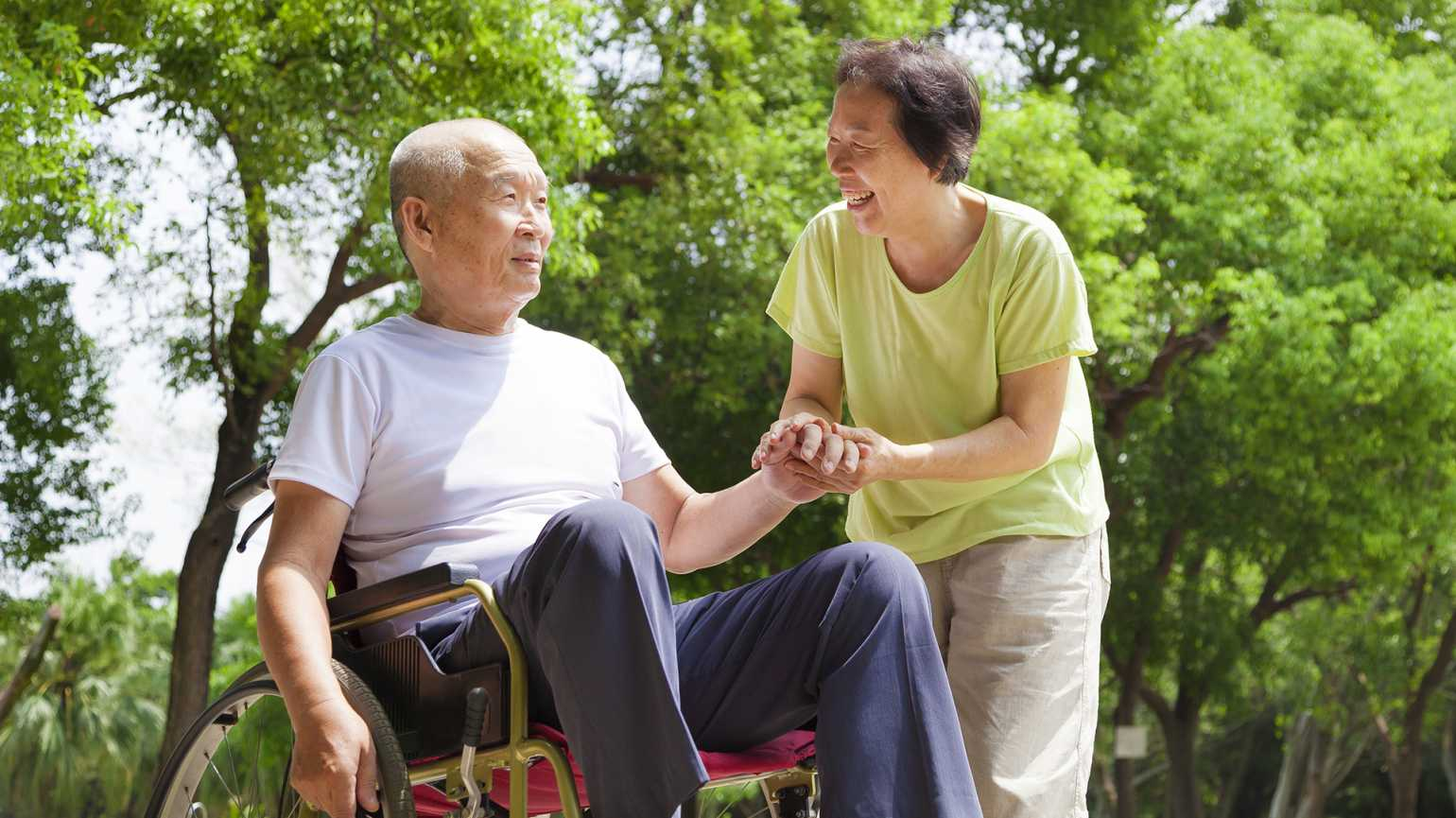A woman serves as caregiver to her spouse