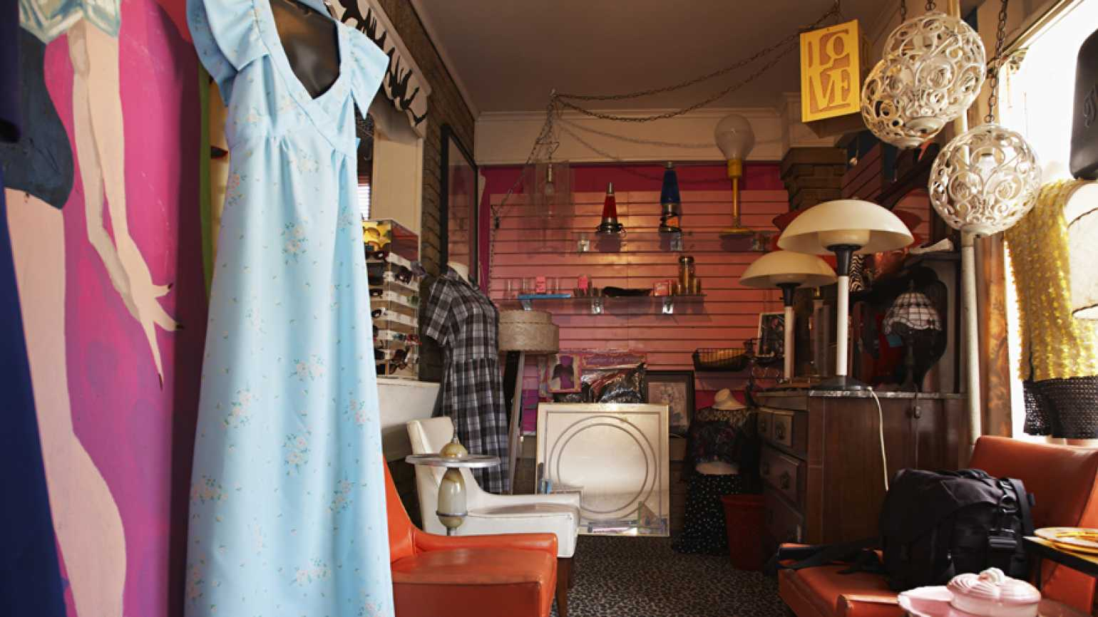 An image of clothes, furniture at a thrift store, save money on holiday shopping | Guideposts