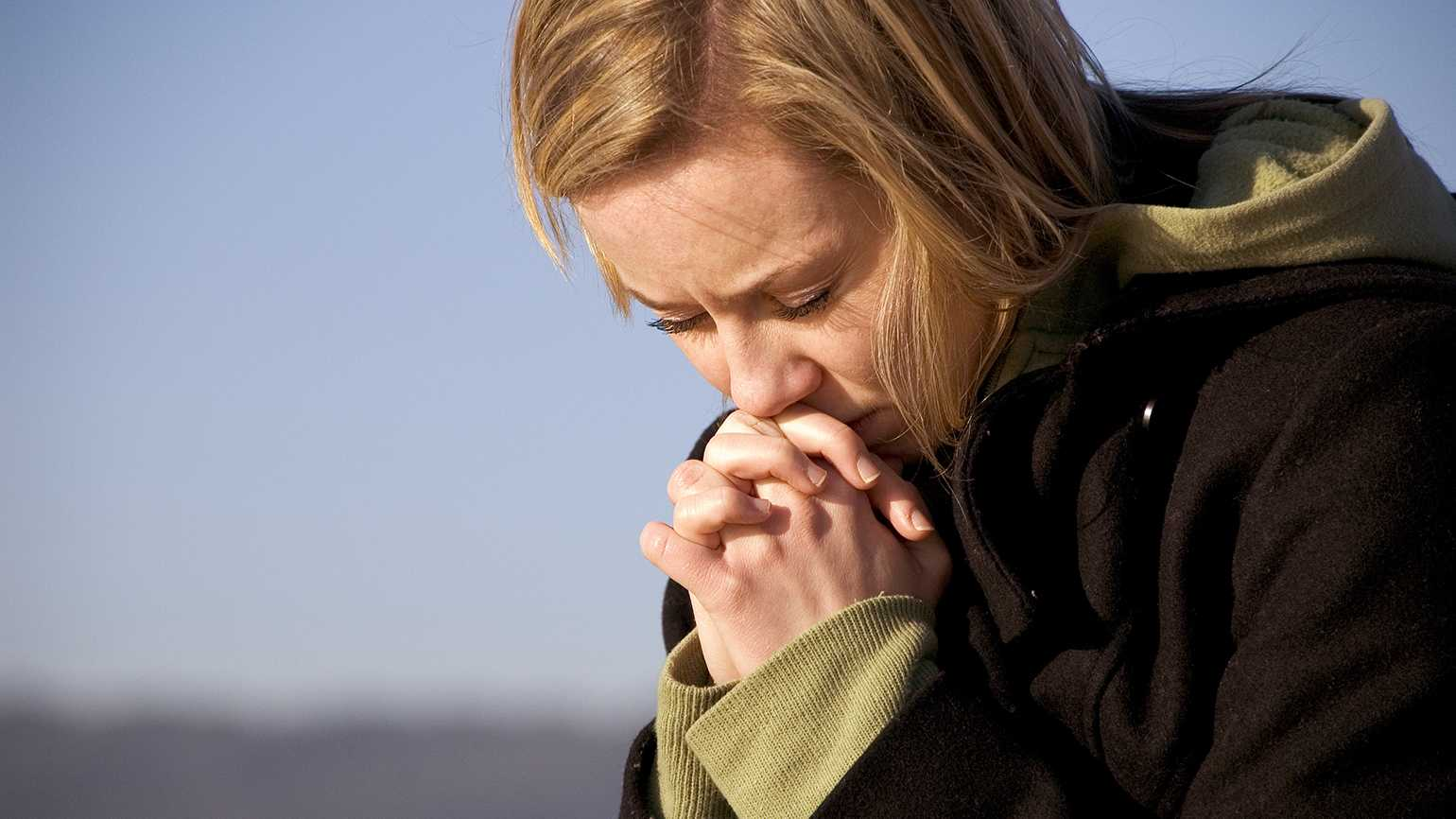 A woman prays for forgiveness