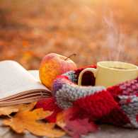 A book, apple, coffee and scarf