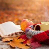 A Bible, an apple, a woolen scarf and a cut of hot chocolate