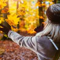 A woman enjoys the fall foliage