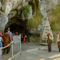 Statue of St. Bernadette at the grotto near Lourdes and the miracle story of the winds.