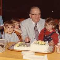 Norman Vincent Peale surrounded by his grandchildren on his 75th birthday.