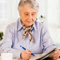 Senior woman doing a crossword puzzle