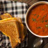 A grilled cheese sandwich and tomato soup