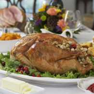 A cooked turkey on a Thanksgiving Day table