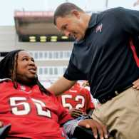 Eric LeGrand with former Rugers coach Greg Schiano