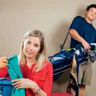 Jennifer Gentlesk sorts laundry while her husband heads for the golf course
