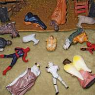 Super hero figurines bow before the Christ child.