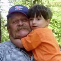 Marie Olson's late husband, Butch, with a grandchild