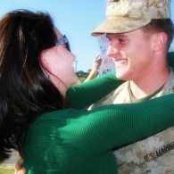 Edie's son Jimmy greeting his wife at the end of his deployment.