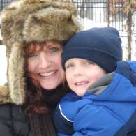 Shawnelle and her son enjoy the first snow of the season.