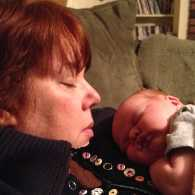 Peggy Frezon with her first grandchild, Grace