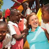 Michelle poses with some of the children she got to know in Haiti.