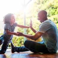 A father enjoys a joy-filled moment with his young son