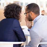 Two people gossiping