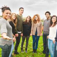 Group of young adults holding hands