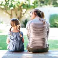 Mother and daughter on porch