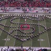 """The Ohio State University Band forms the shape of Superman's """"S"""" insignia."""