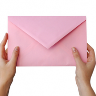 A woman's hands holding a large pink envelope