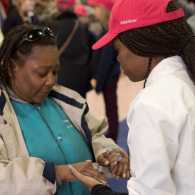 OurPrayer Manager, Ty'Ann Brown prays with another during an OurPrayer Event