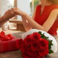 A couple celebrating Valentine's Day with a bouquet of roses and gifts,