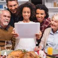 A family chats online with loved ones on Thanksgiving