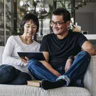 Couple watching videos on their tablet