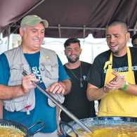José (in blue shirt and vest) and fellow chef volunteers in Puerto Rico making sancocho