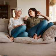 A mother and daughter talking on the couch; Getty Images