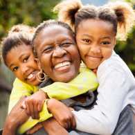 Grandmother and her grandchildren; Getty Images