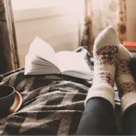 Close up of a woman wearing holidays socks relaxing.