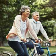 Shot of a mature couple enjoying a bike ride in the park.