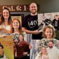 The Bononi family with some of the portraits they rescued; photo courtesy Brian Bononi