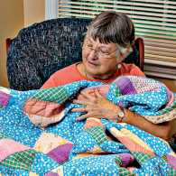 Brenda Graham with a quilt; photo courtesy Brenda Graham