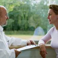 Guideposts: A woman consults with her doctor.