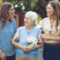 A caregiver and her mother meet a friend in their community.