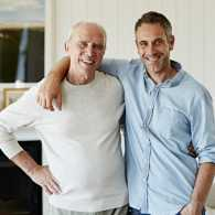 Portrait of a smiling father and son at home.