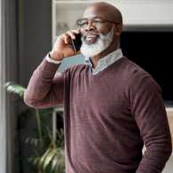 An older gentleman talking to someone over the phone.