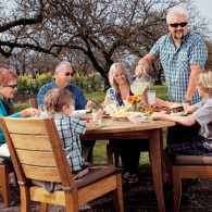 Guideposts: Food Network start Guy Fieri enjoys a meal al fresco with his family.