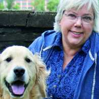 Peggy Frezon and her two golden retrievers, Petey and Earnest