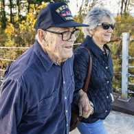 WWII military war veteran father and daughter walking; Getty Images